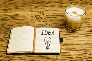 Concept idea lightbulb notebook plan coffee