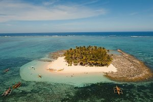 Aerial view beautiful beach on tropical island. Guyam island, Philippines, Siargao.