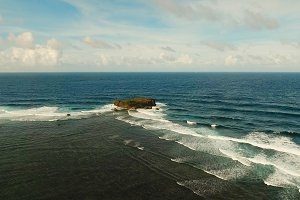 Rock, cliff in the blue sea. Philippines,Siargao.Aerial view.
