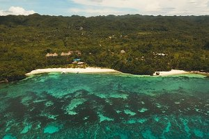 Aerial view beautiful beach on a tropical island. Philippines, Anda area.