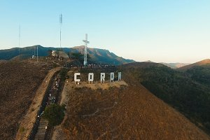 Sign of the city of Coron on the hill.Cross on a hill, Coron, Philippines,Palawan Busuanga.