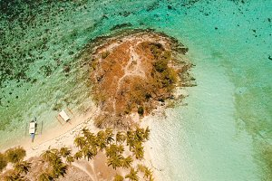 Aerial view beautiful beach on a tropical island Malcapuya. Philippines.