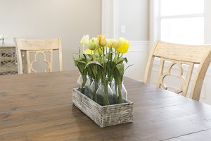 Yellow Tulips on Wood Table