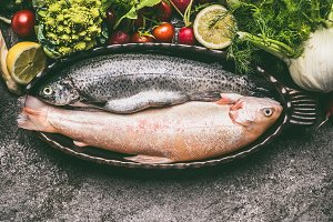 Two trout in baking bowl