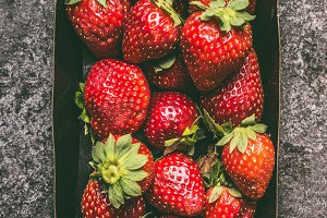 Strawberries in paper crates box