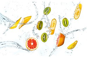 Abstract background with tropical fruits in water drops