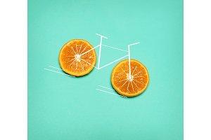 Healthy lifestyle concept - bike with orange wheel on green. Pop art collage