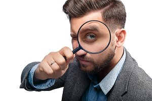 Man with magnifying glass on white background