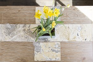Yellow Daffodils on Wood Table