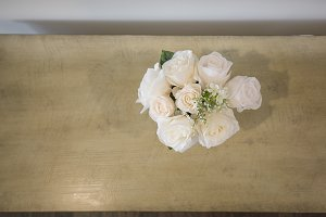 White Roses on Wood Table