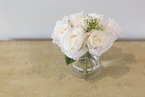 White Roses on Light Wood Table