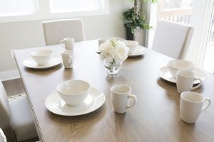 White Table Setting on Wood Table
