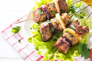 Grilled shish kebab or shashlik on white.