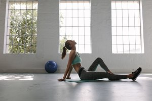 Woman relaxing at gym