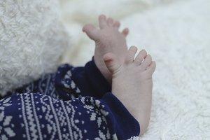 newborn legs wearing in pants