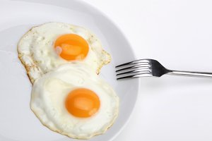 fried eggs with fork