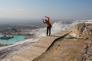 Woman walking on the terraces at Pamukkale. It cotton castle in Turkish and is natural site