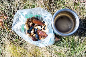 Snack from a variety of nuts. Coffee and nuts.