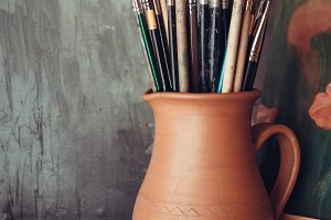 Paintbrushes in a jug