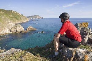 Cyclist sitting on the coast