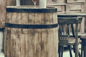 Barrel with bottles in outdoors cafe