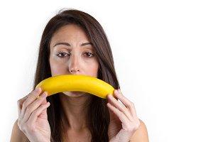 Woman show sad face using a banana