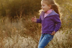 Girl runs on meadow
