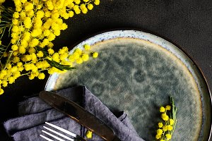 Spring table setting with mimosa