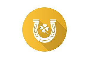 Horseshoe and four leaf clover flat design long shadow glyph icon