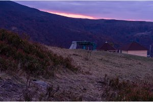 Violet-pink sunset. Autumn sunset in the mountains.