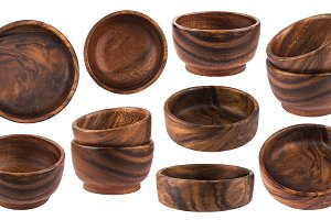 Collection of empty wooden bowls isolated on white background