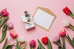 Gift and card on a pink background