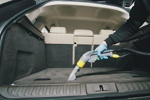 Small business - cleaning of vehicle wardrobe with vacuum cleaner