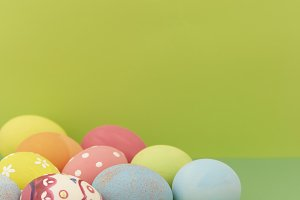 Easter eggs on green background