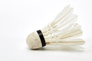 Old shuttlecock isolated on white