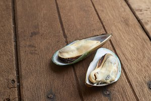Fresh mussel on the old wood