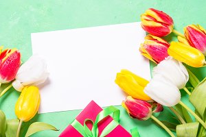 Holiday background or greeting card. Flower and present box.