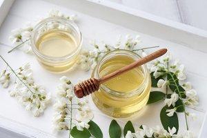 Honey jar with acacia blossoms