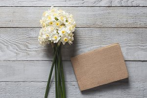 White narcissus flowers and notebook