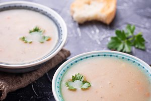 Healthy vegetarian peas soup on concrete background