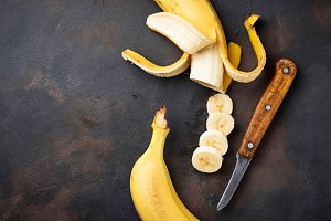 Fresh sliced banana on dark background