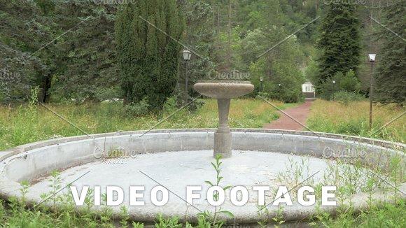 Around the ancient fountain in the park at Romanov Palace - Borjomi, Georgia