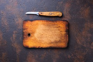 Empty vintage cutting board and knife