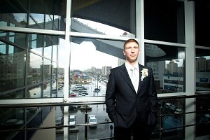 man in suit on the background of a window