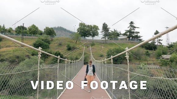 Young Girl Walks On The Suspension Bridge Georgia