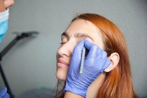 woman paint eyebrow