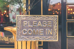 Please come in vintage sign in the store. Asia.