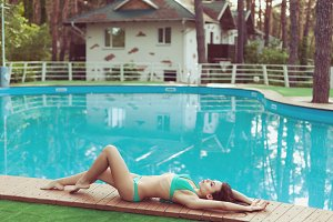 Woman in a bathing suit in a villa.