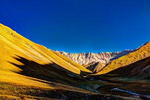 Sunset view to Tash-Rabat river and valley, Naryn province, Kyrgyzstan