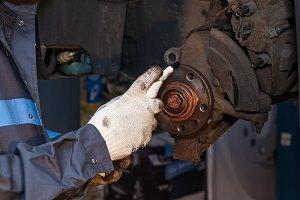 Disk brake repair in the car.